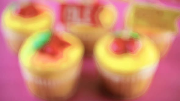 Cupcakes decorated with red chili peppers for Cinco de Mayo.