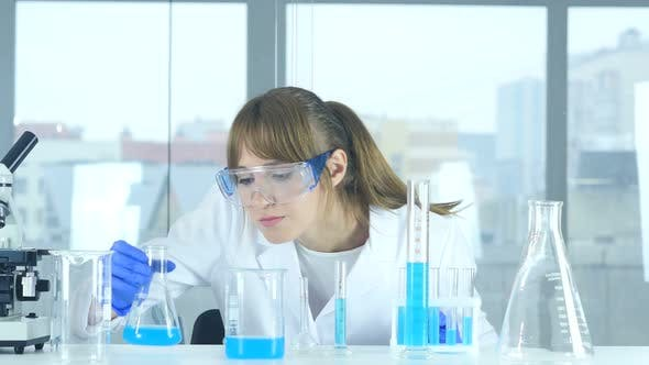Thumbnail for Female Scientist Looking at Reaction Happening in Flask in Laboratory