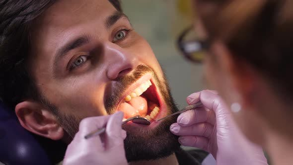Thumbnail for Portrait of Man with Open Mouth in Dental Office