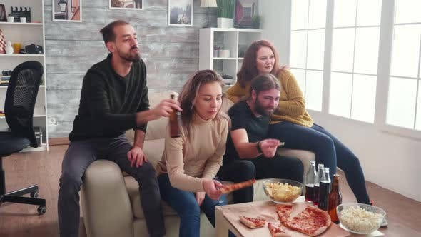 Thumbnail for Group of Caucasian Friends Relaxing Watching Tv Sitting on Couch