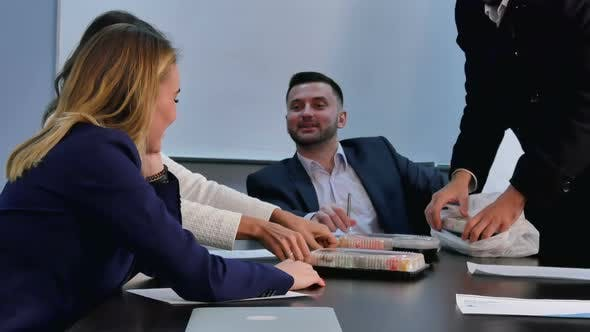 Thumbnail for Young Business People Having Lunch Together in Office