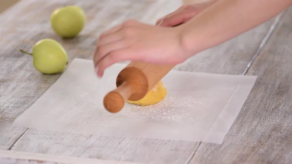 Thumbnail for Woman Rolling Dough on Parchment Paper