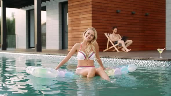 Thumbnail for Sexy Woman Having Fun in Pool. Smiling Model Relaxing in Swimming Pool