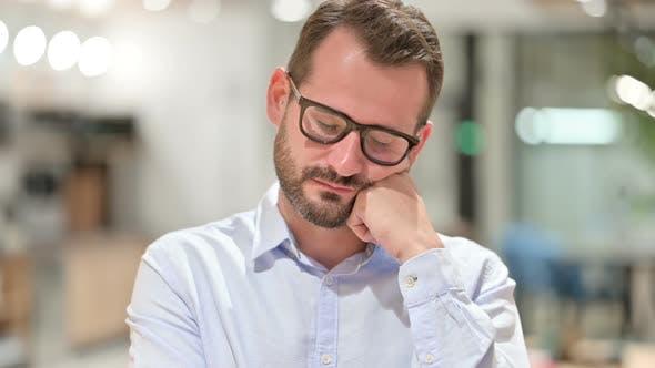 Thumbnail for Portrait of Sleepy Businessman Taking Nap