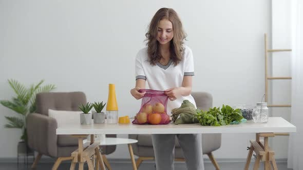 Young Cute Woman Preparing To Cooking a Salad