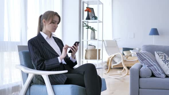 Thumbnail for Woman Using Smartphone, Browsing online at Work