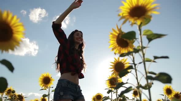 Thumbnail for Cheerful Woman Walking in Field of Sunflowers
