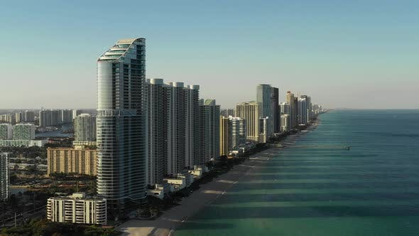 Eroding Florida beaches with highrise towers steps from the shore