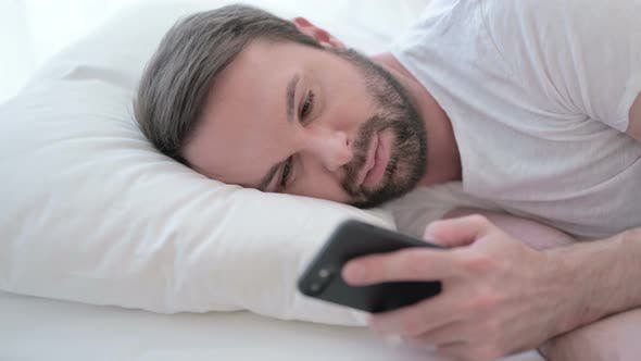 Thumbnail for Close Up of Beard Young Man Using Smartphone in Bed