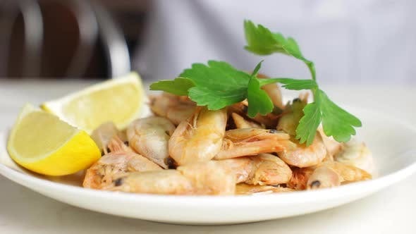 Thumbnail for Chef Decorating Shrimps With Parsley And Slices Of Lemon