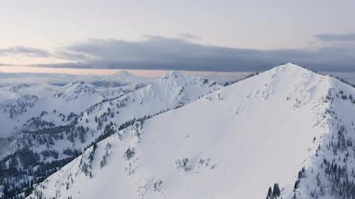 Cascade Mountain Range Snowy Winter Mountain Aerial Drone View Multiple Summit Peaks Near Mt Rainier