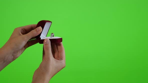 Thumbnail for Displaying silver ring in the box greenscreen display 4K 2160p UltraHD footage - Woman holding box w