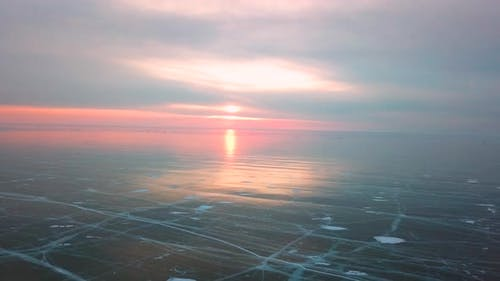Ice with Cracks in Lake Baikal in Winter. Aerial View. Siberia, Russia.