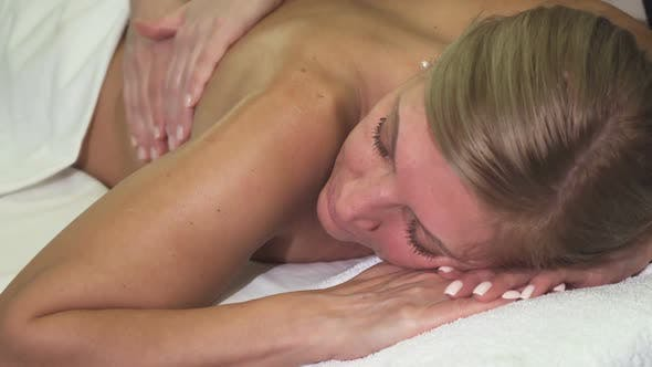 Thumbnail for Experienced Masseuse Makes a Woman a Very High-quality Back Massage