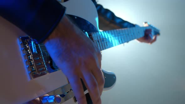 Thumbnail for Close-up View of Rock Musician Mans Hands Masterfully Playing Electric Guitar