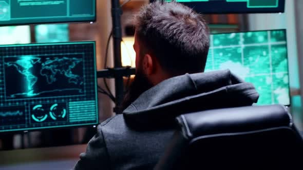 Male Hacker Trying To Steal Secret Information