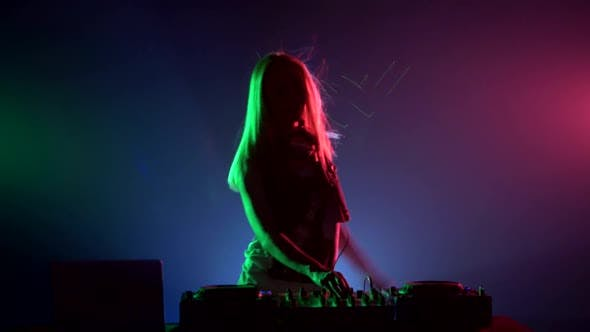 Thumbnail for Attractive, Smiling Dj Girl in Sexy Clothes, Flipping Hair, Hands Up, Enjoy It, Using Headphones