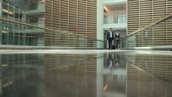 Thumbnail for Businesspeople meeting and greeting each other on walkway