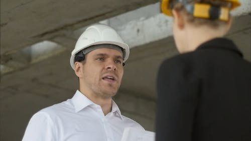 Businessman is angry with architect at construction site