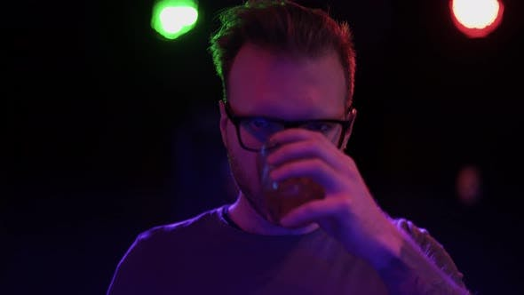 Thumbnail for Portrait of Handsome Bearded Guy in Glasses Drinking Alcoholic Drink From a Glass