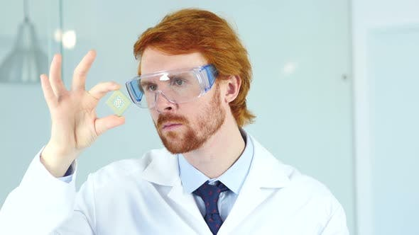 Thumbnail for Scientist Looking on New Electronic Chip of Computer