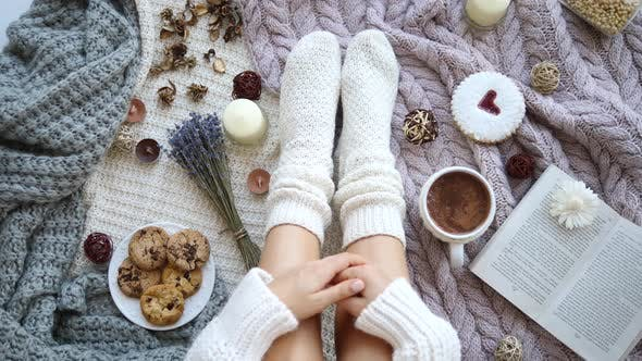 Trendy Flat Lay Blogging Concept. Female Feet In Knitted Socks