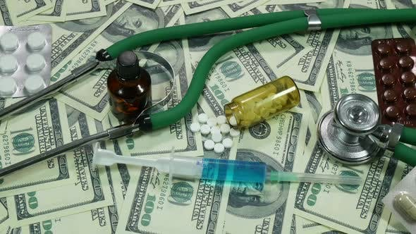 Thumbnail for Dollars And Medical Stethoscope With Medicines