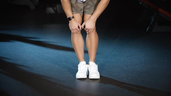 Thumbnail for Sportsman Workout and Trains Legs Joins and Knees Circle Exercises