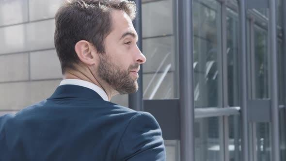 Thumbnail for Business Man Walking Inside Modern Building
