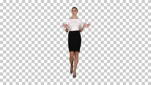 Businesswoman walking and talking to the camera explaining