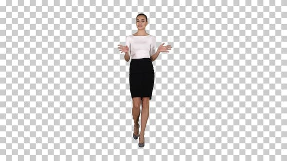 Thumbnail for Businesswoman walking and talking to the camera explaining