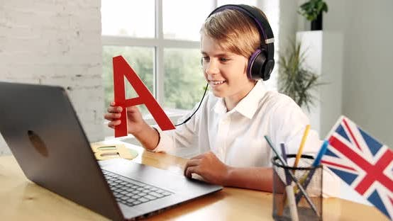 Thumbnail for Boy Studying English Online Laptop