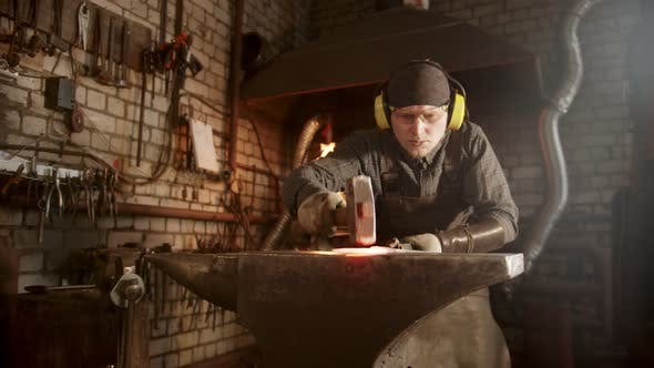 Cover Image for A Man Blacksmith Making a Knife with a Hammer - Looking for Imperfections