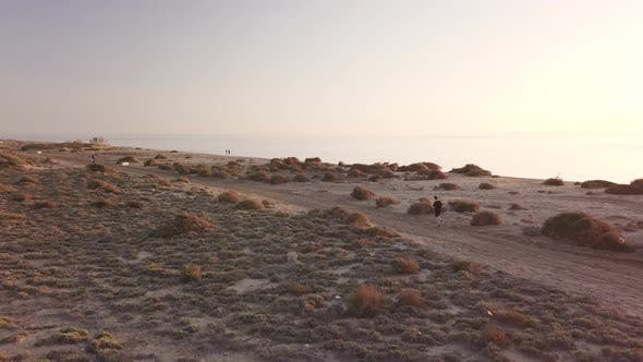 Thumbnail for Young man running in the desert landscape