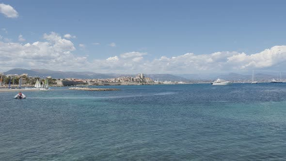 ANTIBES, FRANCE - JULY 2017  French riviera city with beautiful  blue sea and Alps in background