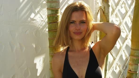 Thumbnail for Blonde Beauty in Black Bikini Posing for the Camera