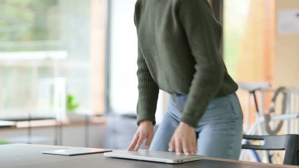 Thumbnail for Young Woman Closing Laptop and Leaving