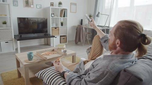 Man Watching Series at Home