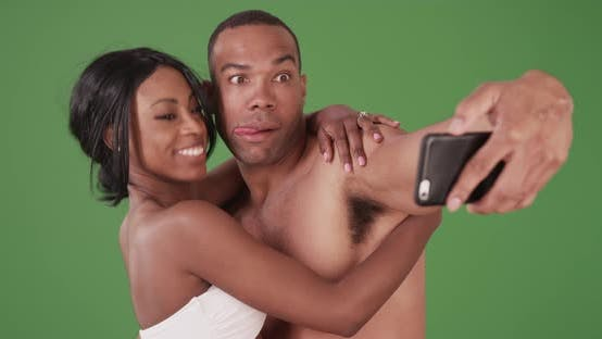 Thumbnail for Engaged couple on honeymoon taking selfies on green screen