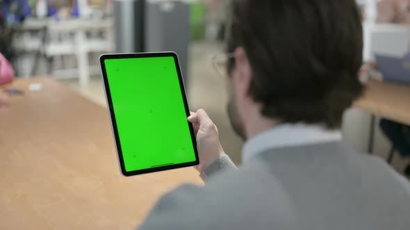 Man Using Tablet with Green Screen