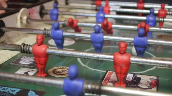 Thumbnail for Close-up shot of people playing an old vintage game of fussball.