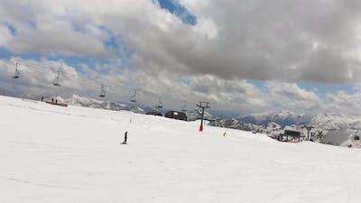 Side View Female Skier Skiing Slow In Gudauri Ski Resort