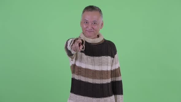 Thumbnail for Happy Mature Japanese Man Pointing at Camera Ready for Winter