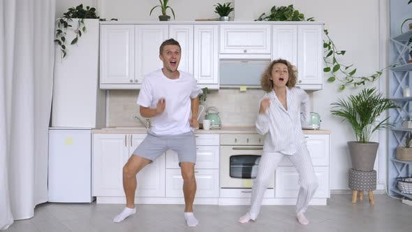 Thumbnail for Happy Family Dance. Funny Cheerful Couple Dancing On Kitchen