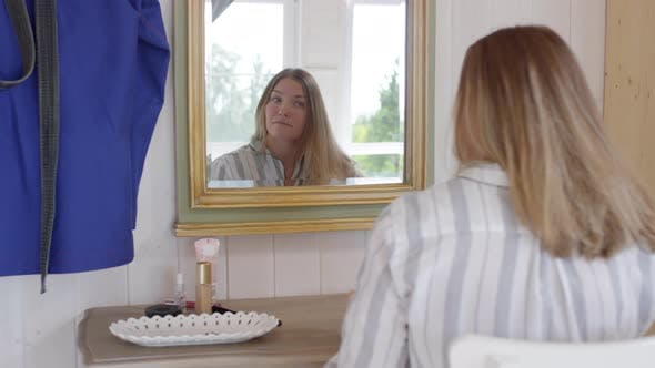 Thumbnail for Woman in Pajama Brushing Hair before Mirror