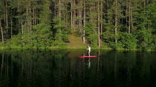 Thumbnail for Woman Paddling Stand Up Paddle Board
