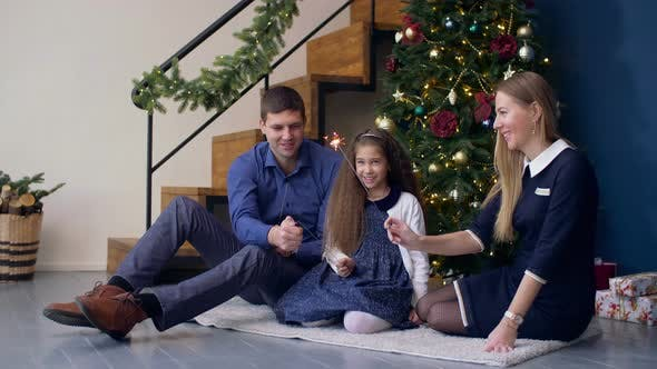 Thumbnail for Happy Family with Sparklers Celebrating Christmas