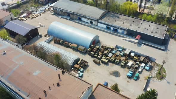 Thumbnail for Birds Eye View of an Old Storage Rooms with Broken Cars and Trucks