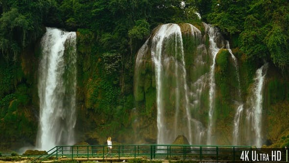Thumbnail for 4K Woman Walking in Front of Bao Gioc Waterfall in Cao Bang, Vietnam