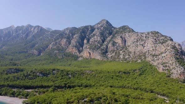High Rocky Mountains on Blue Sky Background